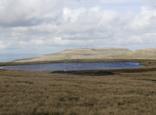Approaching West Baugh Fell Tarn with Wild Boar Fell in the distance