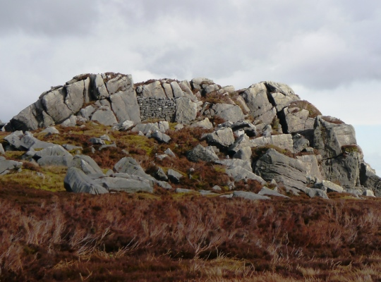 The Wig Stones, note the small buit wall halfway up the crag