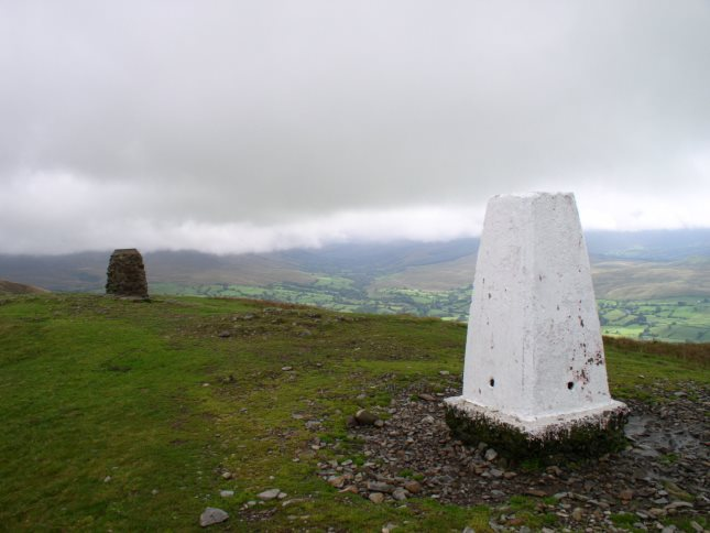 The Winder Hill trig point looking beyond the neighbouring topograph towards Garsdale