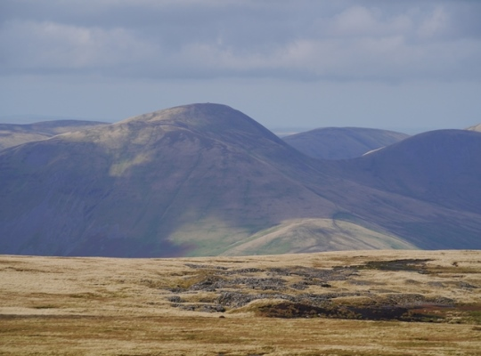 A close up of Yarlside in the Howgill Fells with the remains of Baugh Fell Quarry in the foreground