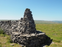 The seat cairn at the top of the permissive path
