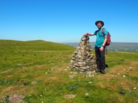 The rebuilt trig point with the summit behind me.