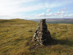 The rebuilt trig point looking to the top of Addlebrough