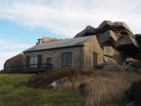 The shooting lodge tucked under Combs Crags
