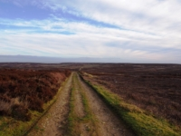 Following the byway over Arnagill Moor with Sandy Hill on the skyline