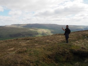 Tony taking a photo with Great Whernside in the distance