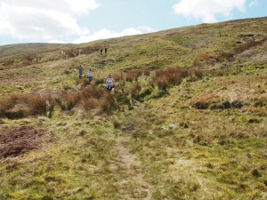 The team descending the sometimes faint bridleway