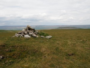 A cairn on Stake Fell with Addlebrough beyond