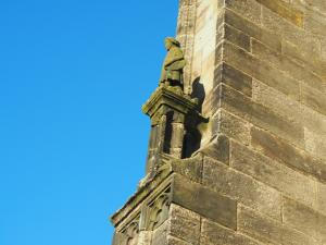 A small statue on the side of the priory
