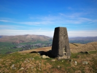 The Holme Knott trig point looking towards Sedbergh and the Howgill Fells