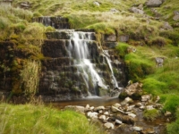 A waterfall below the path in Shaw Gate Gill