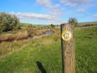 A Pennine Journey waymarker alongside River Bain