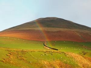Sunshine and a rainbow on Blease Fell