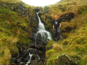 Wally alongside the waterfall on Small Gill