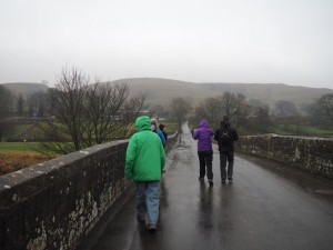 Setting off across Conistone Bridge