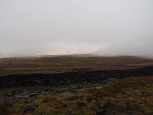 A brief opening in the cloud reveals part of Wharfedale
