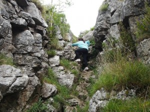 Rhiannon scrambling out of the top of Conistone Dib
