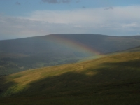 A rainbow over Langstrothdale with Buckden Pike in the background