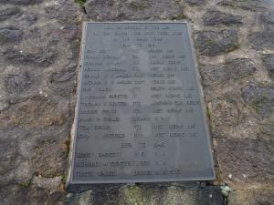 The memorial plaque on the obelisk