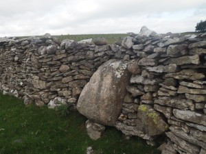 A Shap Granite boulder built into the wall on Slack Randy