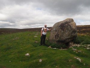 A masssive boulder of Shap Granite on a shattered limestone plinth