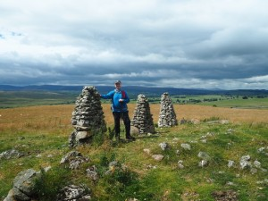 Paul alongside the three cairns on  Hardendale Nab