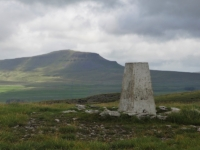 The trig point on the summit of Moughton looking towards Pen-y-Ghent