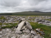The small cairn on the summit of Thwaite Scars looking towards Ingleborough