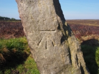 The OS Benchmark on the stone near the parking area
