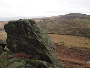 Looking back at Sharp Haw from a large gritstone boulder on Rough Haw