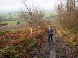 Paul on the muddy path through High Wood