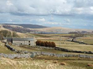 Capon Hall and a distant Malham Tarn