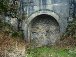 The closed off tunnel entrance to the old railway to Scar House Reservoir