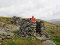 Tim by one of the large cairns overlooking Kingsdale
