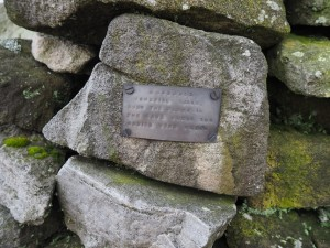 The memorial plaque attached to the cairn