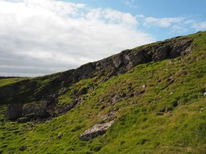 What looks like an old quarry below the top of Wold Fell