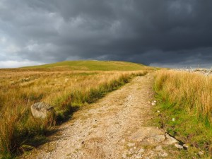 The dark skies chasing me off Wold Fell