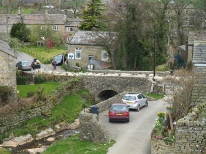 A flock of sheep crossing the bridge in West Scrafton