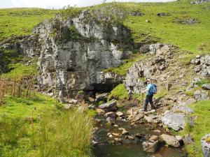 The stream dropping into Buttertubs remerges here