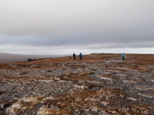 Struggling across the windy summit plateau