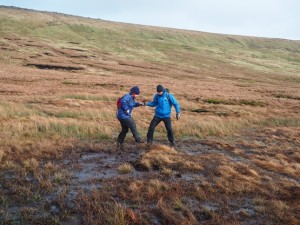 Two of the team carefully crossing the bogs above Hag Dyke