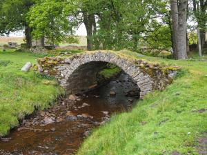 An old packhorse bridge leading to East and West Scales