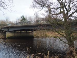 The modern road bridge carrying the A59 over the River Wharfe