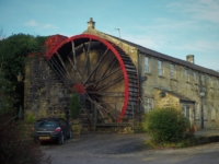 The huge mill wheel next to the Bridge Inn