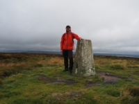 By the trig point on the top of Ilkley Moor