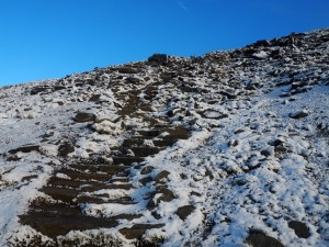 The final steps up to the summit plateau