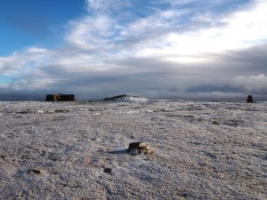 The shelter, cairn and trig point on the summit