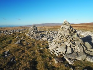 Twin cairns at Grey Scars