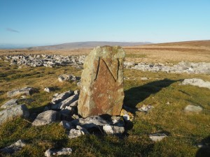 The boundary stone near the two cairns