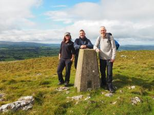 Sam, Tony and Mick by the Tow Scar Trig Point